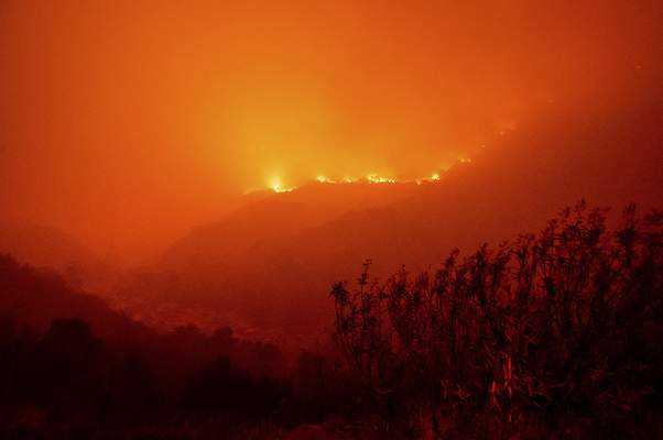 Flames from the KNP Complex Fire burn along a hillside above the Kaweah River in Sequoia National Park, Calif., on Tuesday, Sept. 14, 2021. (AP Photo/Noah Berger)