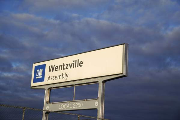 In this March 24, 2021 photo, a sign stands near an entrance to a General Motors assembly plant in Wentzville, Mo. (AP Photo/Jeff Roberson)