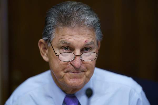 FILE - In this Aug. 5, 2021, file photo Sen. Joe Manchin, D-W.Va., prepares to chair a hearing in the Senate Energy and Natural Resources Committee, as lawmakers work to advance the $1 trillion bipartisan bill, at the Capitol in Washington. (AP Photo/J. Scott Applewhite, File)