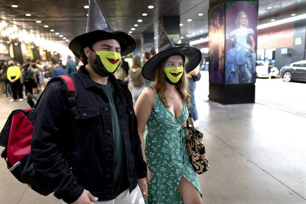 Friends Adam Schaefer and Isabella Phillips of Philadelphia attend the opening of Wicked at the Gershwin Theatre Tuesday, Sept. 14, 2021, in New York. (AP Photo/Craig Ruttle)