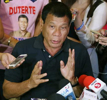FILE - In this April 29, 2016 file photo, presidential candidate Rodrigo Duterte answers questions from the media in Manila, Philippines. (AP Photo/Bullit Marquez, File)