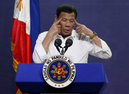 FILE - In this Tuesday Aug. 27, 2019 file photo Philippine President Rodrigo Duterte gestures as he addresses land reform beneficiaries on the 31st year of the implementation of the Comprehensive Agrarian Reform Program (CARP) in suburban Quezon city northeast of Manila, Philippines. (AP Photo/Bullit Marquez, File)