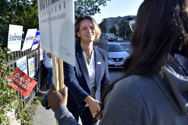 Mayoral Candidate City Councilor Annissa Essaibi George greets campaigners outside a polling place in the Roxbury neighborhood of Boston on Tuesday, Sept. 14, 2021 in a preliminary mayoral election that will select two top contenders from a field of five candidates all of whom are people of color, four of them women. (AP Photo/Josh Reynolds)