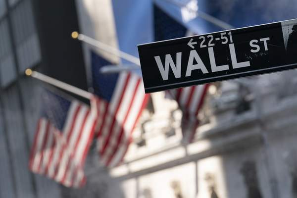 A sign for Wall Street hangs in front of the New York Stock Exchange, July 8, 2021. Stocks edged lower in morning trading, quickly reversing course after a brief gain following the latest data on inflation. (AP Photo/Mark Lennihan, file)