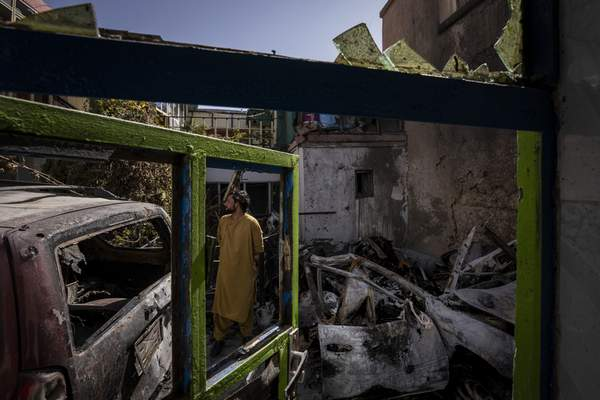 Associated Press An Afghan inspects the damage to Zemerai Ahmadi's family house in Afghanistan. Ahmadi was killed in a U.S. drone strike but was a longtime employee at an American humanitarian organization.