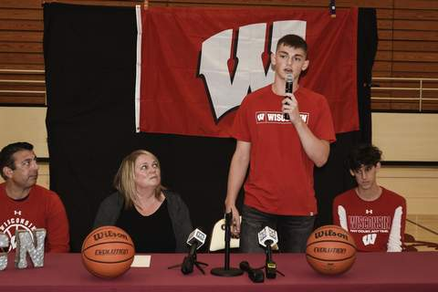 Mike Moore | The Journal Gazette Central Noble senior Connor Essegian announces Wednesday he'll play basketball at Wisconsin.