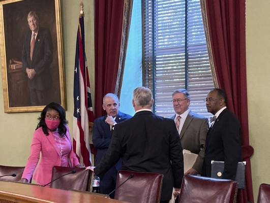 FILE - In this Friday, Aug. 6, 2021 file photo, from left to right, Ohio House Democratic Leader Emilia Sykes, Senate President Matt Huffman, House Speaker Bob Cupp, both Republicans, and Democratic state Sen. Vernon Sykes speak to Auditor Keith Faber at the Ohio Statehouse in Columbus, Ohio, ahead of the first meeting of the Ohio Redistricting Commission on which they all sit. (AP Photo/Julie Carr Smyth, File)