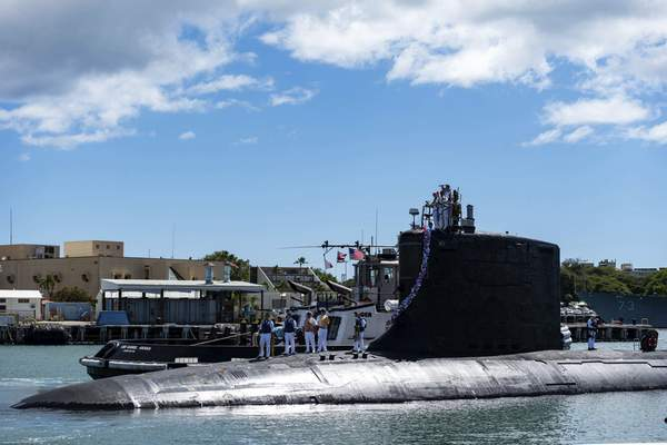 In this photo provided by U.S. Navy, the Virginia-class fast-attack submarine USS Illinois (SSN 786) returns home to Joint Base Pearl Harbor-Hickam from a deployment in the 7th Fleet area of responsibility on Sept. 13, 2021. (Mass Communication Specialist 1st Class Michael B. Zingaro/U.S. Navy via AP)