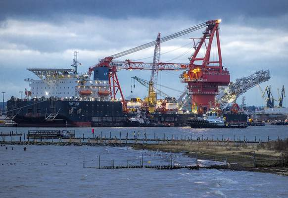 FILE - In this Jan. 14, 2021 file photo, Tugboats get into position on the Russian pipe-laying vessel Fortuna in the port of Wismar, Germany. ( Jens Buettner/dpa via AP, File)