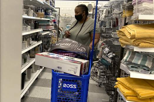 Retail Sales In this July 21, 2021 photo, a consumer shops as she wears a mask at a retail store in Morton Grove, Ill. Americans kept shopping last month, despite a rise in COVID-19 cases. (AP Photo/Nam Y. Huh) (Nam Y. Huh STF)