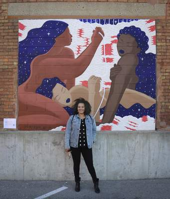 """Courtesy Local artist Lyndy Bazile completed""""Woven,"""" a mural for Art This Way, at 222 Pearl St. last year."""