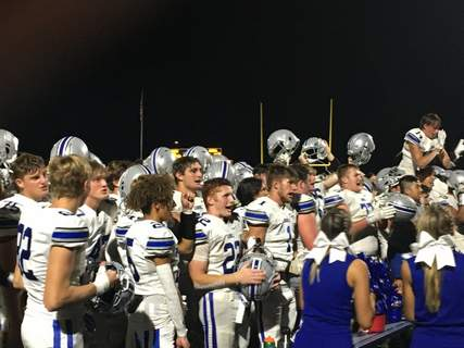 Dylan Sinn | The Journal Gazette  Carroll players celebrate the Chargers' 42-23 win over Bishop Dwenger on Friday night at Shields Field by singing the school song. It's the first time Carroll has beaten the Saints since 2017.
