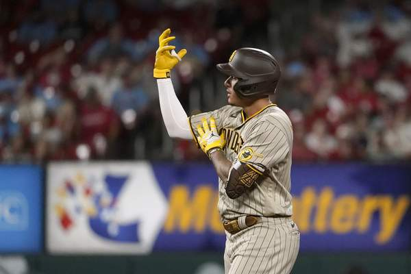 San Diego Padres' Manny Machado celebrates after hitting a double during the sixth inning of a baseball game against the St. Louis Cardinals Friday, Sept. 17, 2021, in St. Louis. (AP Photo/Jeff Roberson)