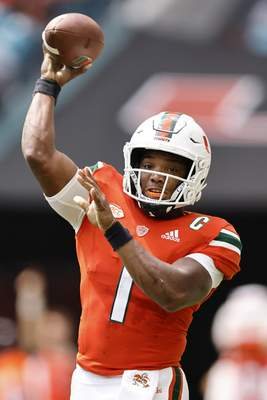 Miami quarterback D'Eriq King (1) throws a pass during the first quarter of an NCAA college football game against Michigan State, Saturday, Sept. 18, 2021, in Miami Gardens, Fla. (AP Photo/Michael Reaves)