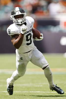 Michigan State running back Kenneth Walker III (9) runs with the ball during the second quarter of an NCAA college football game against Miami, Saturday, Sept. 18, 2021, in Miami Gardens, Fla. (AP Photo/Michael Reaves)