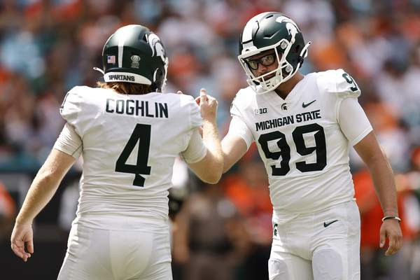 Michigan State place kicker Matt Coghlin (4) celebrates a made field goal with punter Bryce Baringer (99) during the second quarter of an NCAA college football game against Miami, Saturday, Sept. 18, 2021, in Miami Gardens, Fla. (AP Photo/Michael Reaves)