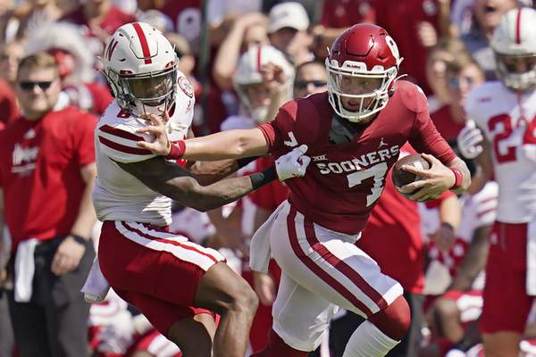 Oklahoma quarterback Spencer Rattler (7) grabs the face mask of Nebraska cornerback Quinton Newsome (6) as he carries in the first half of an NCAA college football game, Saturday, Sept. 18, 2021, in Norman, Okla. (AP Photo/Sue Ogrocki)
