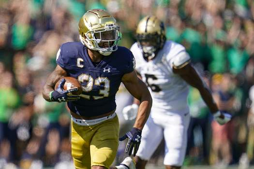 Purdue Notre Dame Football Associated Press Notre Dame running back Kyren Williams runs for a touchdown in front of Purdue linebacker Jalen Graham during the first half Saturday in South Bend. (Michael ConroySTF)