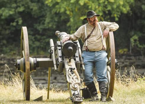 Mike Moore   The Journal Gazette A cannon crew member watches the crowds Saturday at the Johnny Appleseed Festival.