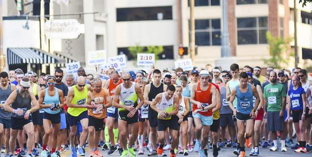 Photos by Katie Fyfe   The Journal Gazette The 14th annual Fort4Fitness half marathon begins Saturday morning along Baker Street downtown.