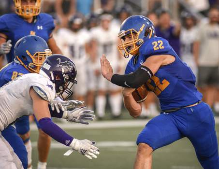 Mike Moore | The Journal Gazette Running back Kainon Carico and his East Noble teammates made their game against Leo on Friday close despite trailing early.