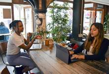 Britain Changing Economy Office Newbies Associated Press Sonya Barlow, right, CEO of Like Minded Females Network, speaks to intern Rebekah Ingram at a coffee shop in London. The organization helps young women set up businesses and other ventures without a fixed office space. (Urooba JamalSTR)