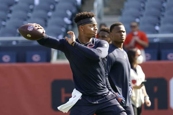 Chicago Bears quarterback Justin Fields warms up before an NFL football game against the against the Cincinnati Bengals Sunday, Sept. 19, 2021, in Chicago. (AP Photo/Nam Y. Huh)