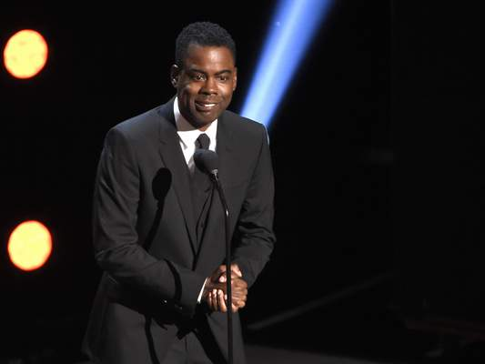 FILE - In this March 30, 2019 file photo, Chris Rock presents the award for outstanding comedy series at the 50th annual NAACP Image Awards at the Dolby Theatre in Los Angeles. (Photo by Chris Pizzello/Invision/AP, File)