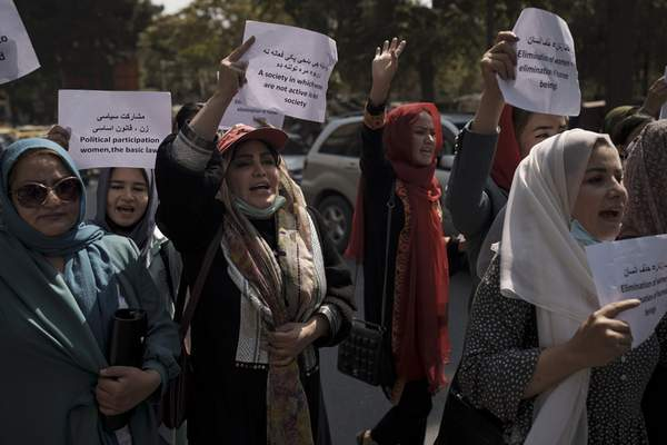 Women march to demand their rights under the Taliban rule during a demonstration near the former Women's Affairs Ministry building in Kabul, Afghanistan, Sunday, Sept. 19, 2021. (AP Photo)