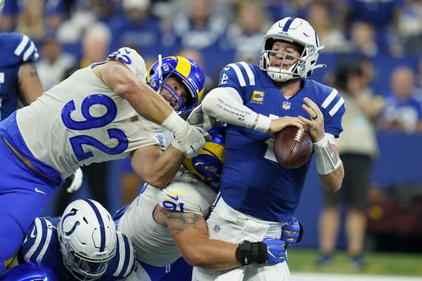 Associated Press Colts quarterback Carson Wentz is sacked by the Rams' Greg Gaines during the first half Sunday. Wentz left the game in the second half with an injured ankle.