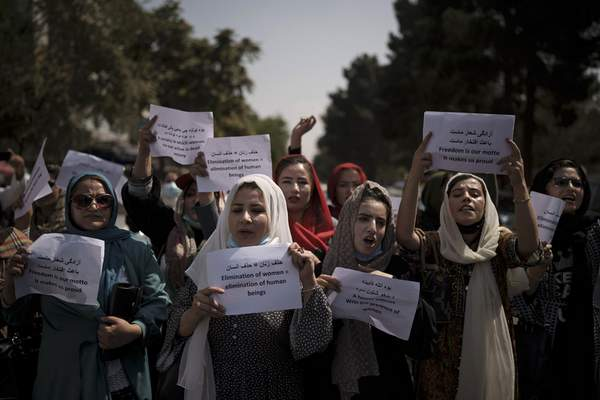 Associated Press  Afghan women march to demand their rights under the Taliban rule during a demonstration near the former Women's Affairs Ministry building in Kabul, Afghanistan, Sunday, Sept. 19, 2021. The interim mayor of Afghanistan's capital said Sunday that many female city employees have been ordered to stay home by the country's new Taliban rulers. (AP Photo)