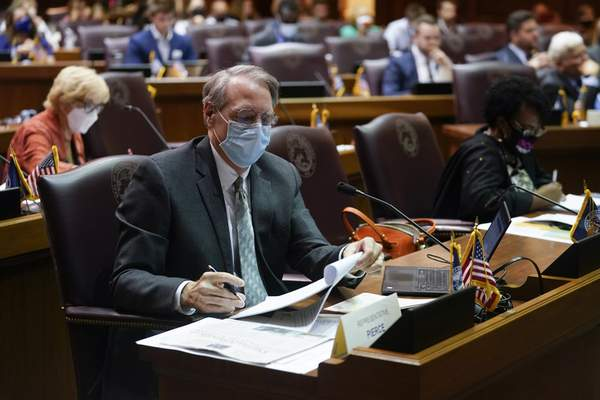 Rep. Matt Pierce listens during a public hearing on the redistricting plan at the Statehouse, Thursday, Sept. 16, 2021, in Indianapolis. (AP Photo/Darron Cummings)