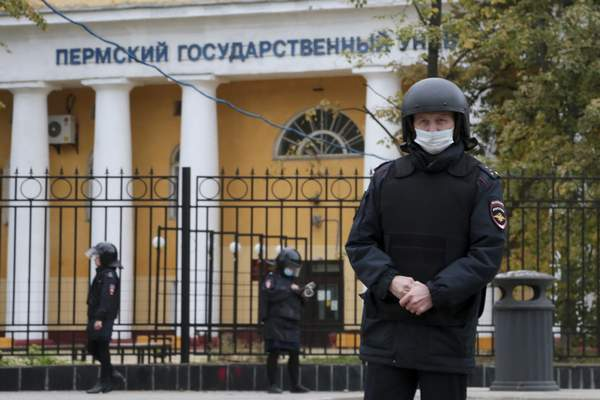 Police officers guard an area in front of the Perm State University in Perm, about 1,100 kilometers (700 miles) east of Moscow, Russia, Monday, Sept. 20, 2021. A gunman opened fire in a university in the Russian city of Perm on Monday morning, leaving at least eight people dead and others wounded, according to Russia's Investigative Committee. (AP Photo)