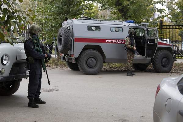 Police guard an area near the Perm State University in Perm, about 1,100 kilometers (700 miles) east of Moscow, Russia, Monday, Sept. 20, 2021. A gunman opened fire in a university in the Russian city of Perm on Monday morning, leaving at least eight people dead and others wounded, according to Russia's Investigative Committee. (AP Photo/Anastasia Yakovleva)