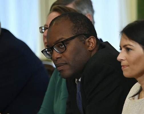 FILE - In this Friday, Sept. 17, 2021 file photo, Britain's Business Secretary Kwasi Kwarteng, center, participates in the first Cabinet meeting since the reshuffle, at 10 Downing Street, in London, Friday, Sept. 17, 2021. (Ben Stansall/Pool Photo via AP, File)