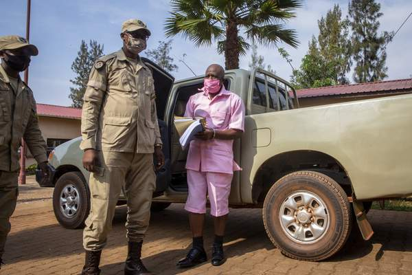 FILE - In this Friday, Sept. 25, 2020 file photo, Paul Rusesabagina, whose story inspired the film Hotel Rwanda for saving people from genocide, wears a pink prison uniform as he arrives for a bail hearing at a court in the capital Kigali, Rwanda. (AP Photo/Muhizi Olivier, File)