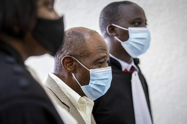 FILE - In this Monday, Sept. 14, 2020 file photo, Paul Rusesabagina, center, whose story inspired the film Hotel Rwanda for saving people from genocide, appears at the Kicukiro Primary Court in the capital Kigali, Rwanda. (AP Photo, File)