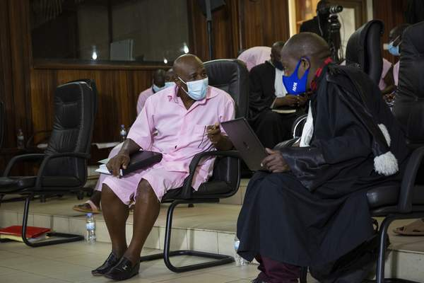 FILE - In this Friday, Feb. 26, 2021 file photo, Paul Rusesabagina, whose story inspired the film Hotel Rwanda for saving people from genocide, speaks to lawyers as he attends a court hearing in Kigali, Rwanda. (AP Photo/Muhizi Olivier, File)