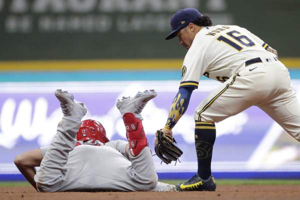 Associated Press The Cardinals' Matt Carpenter slides safely into second base past the tag of the Brewers' Kolten Wong for a double Monday.