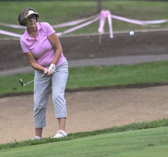 Michelle Davies | The Journal Gazette Tara Armstrong of Auburn chips her ball onto the green of the second hole at Fort Wayne Country Club during Monday's Vera Bradley Foundation for Breast Cancer Classic.