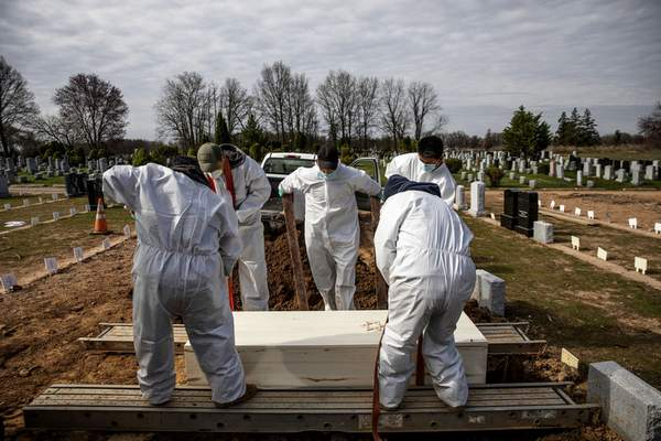 Associated Press In April 2020, the casket of a COVID-19 victim is lowered at acemetery in the Staten Island borough of New York.The pandemic has killed 675,000 Americans.