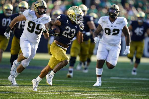 Notre Dame running back Kyren Williams (23) runs for a touchdown against Purdue during the second half of an NCAA college football game in South Bend, Ind., Saturday, Sept. 18, 2021. Notre Dame defeated Purdue 27-13. (AP Photo/Michael Conroy)