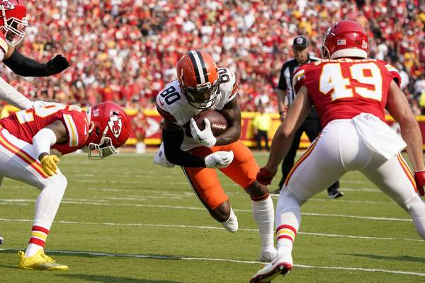 Cleveland Browns wide receiver Jarvis Landry (80) runs for a touchdown between Kansas City Chiefs safety Juan Thornhill, left, and safety Daniel Sorensen (49) during the first half of an NFL football game against the Kansas City Chiefs Sunday, Sept. 12, 2021, in Kansas City, Mo. (AP Photo/Ed Zurga)