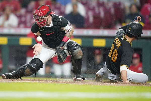 Associated Press Pittsburgh's Hoy Park scores ahead of the tag from catcher Tucker Barnhart during the sixth inning Tuesday in Cincinnati.