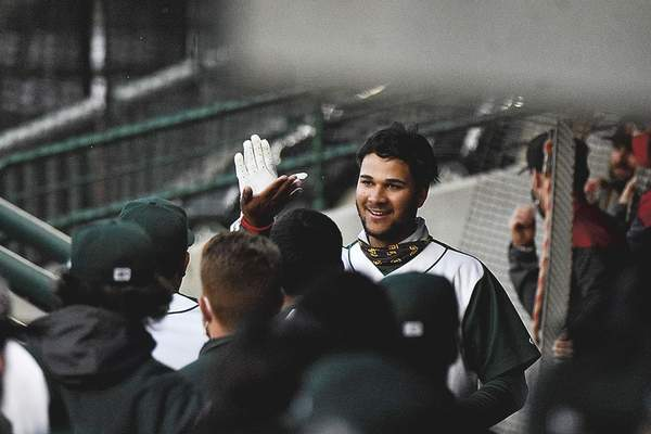 Katie Fyfe | The Journal Gazette MAY 4: Justin Lopez high fives teammates after hitting a grand slam in the Tincaps' win over the West Michigan Whitecaps in the season opener at Parkview Field. It was the team's first game in over 600 days.