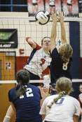 Mike Moore   The Journal Gazette Heritage right side hitter Allison Richman sends the ball over the net Tuesday against Woodlan in Monroeville.