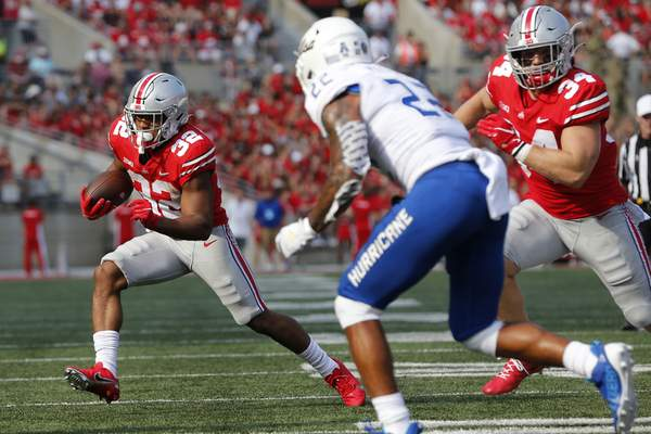 Associated Press photos Ohio State running back TreVeyon Henderson set the freshman single-game rushing record with 277 yards Saturday.