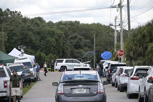 Missing Traveler Associated Press Vehicles from members of the media and curious passersby line a road outside the entrance of the Carlton Reserve in Venice, Fla., Tuesday during a search for Brian Laundrie, a person of interest in the death of his girlfriend, Gabby Petito. (Phelan M. EbenhackFRE)