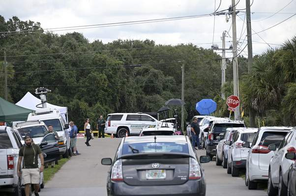 Associated Press Vehicles from members of the media and curious passersby line a road outside the entrance of the Carlton Reserve in Venice, Fla., Tuesday during a search for Brian Laundrie, a person of interest in the death of his girlfriend, Gabby Petito.