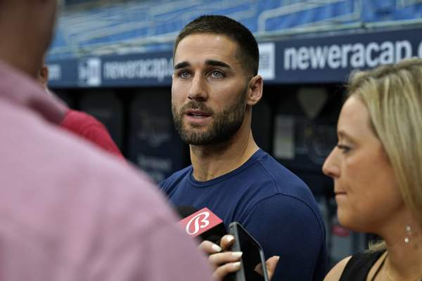 Tampa Bay Rays' Kevin Kiermaier talks to reporters before a baseball game against the Toronto Blue Jays Wednesday, Sept. 22, 2021, in St. Petersburg, Fla. Kiermaier was answering questions about picking up the Blue Jays pitch data card after being tagged out at home plate by catcher Alejandro Kirk during Monday's game. (AP Photo/Chris O'Meara)